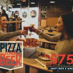 girls toasting beer and wine with pizza on the table